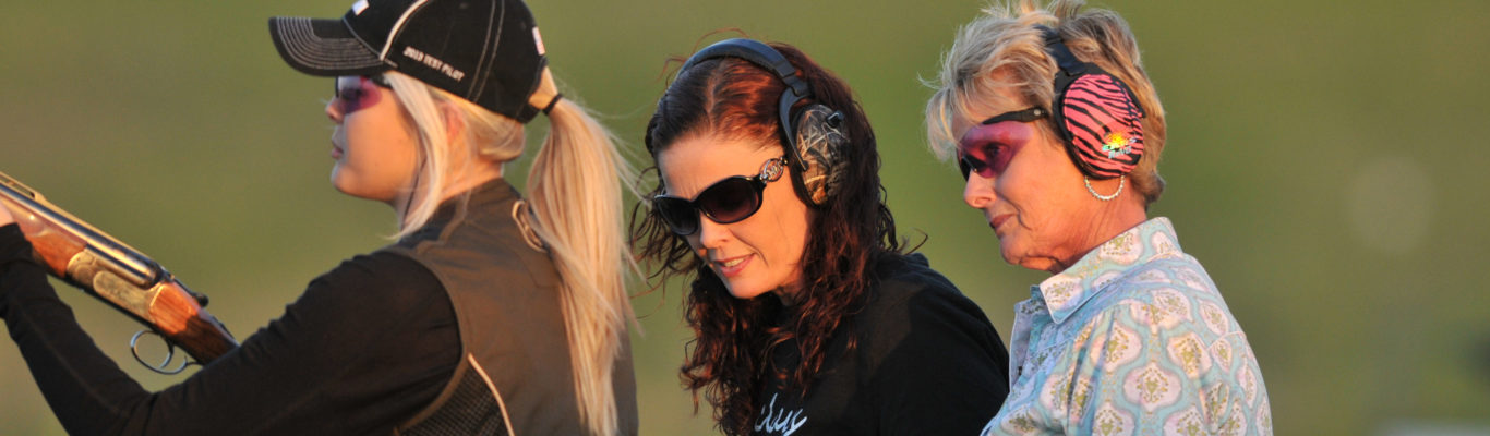 Grandmother, Mother, and Daughter shooting clay targets